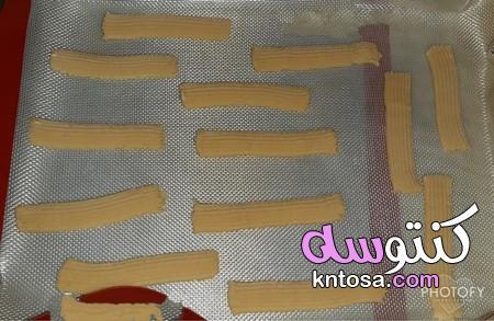 طريقة عمل بسكويت البرتقال بالزبدة، طريقة عمل بسكويت النشادر بالصور kntosa.com_10_20_157
